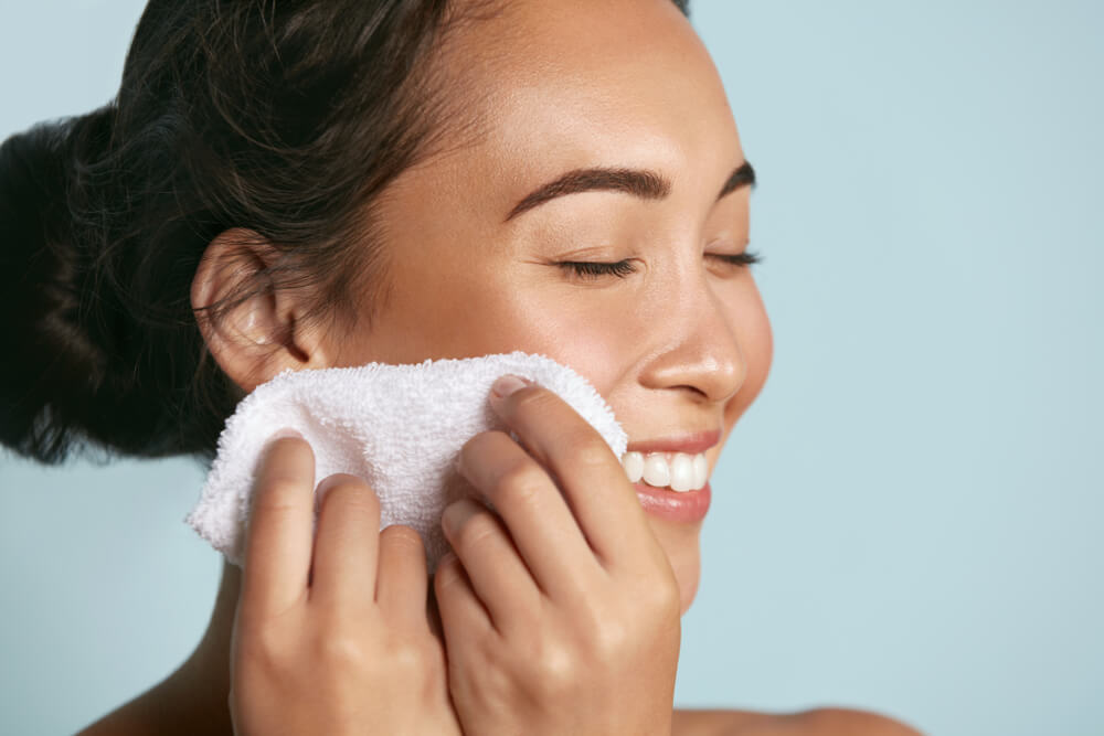 Woman wiping clean face