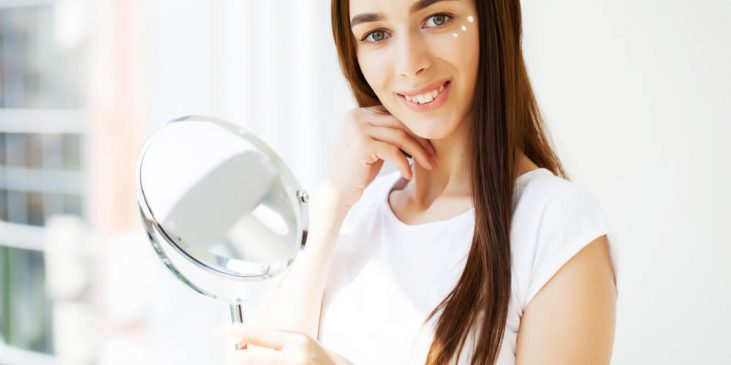 Woman applying Lavelier Eye Firming Concentrate