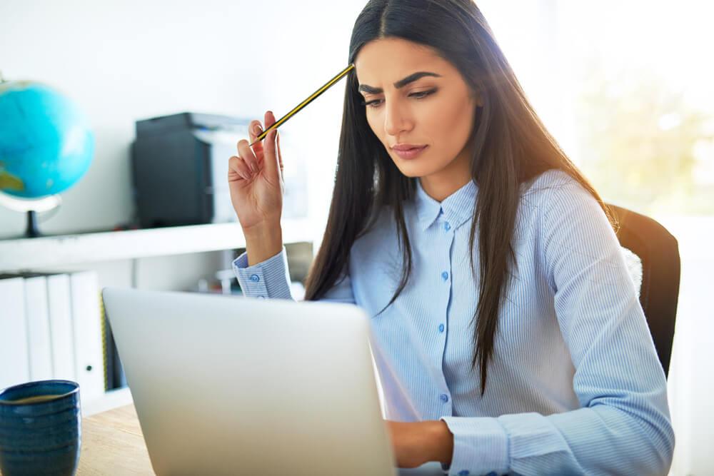 Woman frowning at laptop