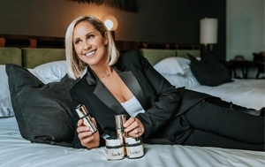 Woman laying on bed with lavelier products